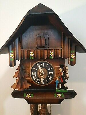 Chalet Cuckoo Clock with Hand Carved Clock man- fully functional