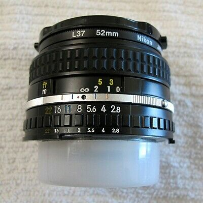 Nikon NIKKOR 28 mm f/2.8 Lens Ai-s manual with Nikon L37 52 mm filter and caps