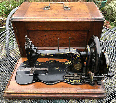 A 19th century 1883 12K Singer fiddle base sewing machine with case, working!