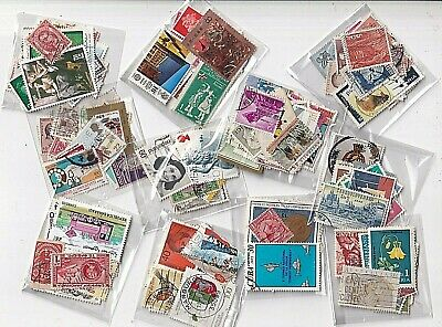 World wide collection....10 little bags with used stamps off paper