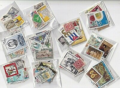 World wide collection....10 + 1 little bags with used stamps off paper