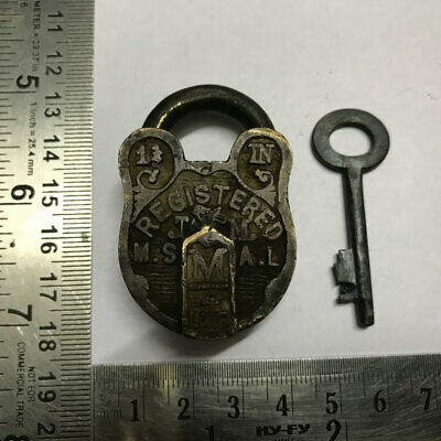 An old antique solid brass miniature padlock lock with key and nice carving