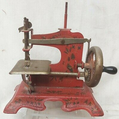 Antique Childs Metal Sewing Machine Toy - Unusal Red with Bird Decorations