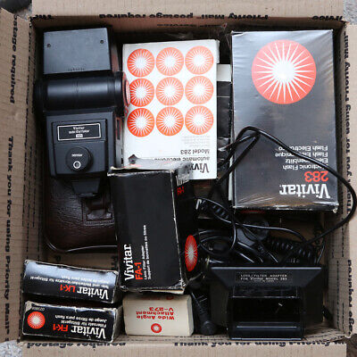 Box of Vivitar flashes with acessories