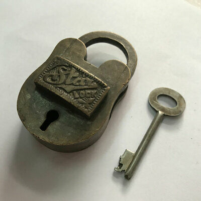 An Old or antique brass padlock lock key nice decorative shape TRICK or PUZZLE