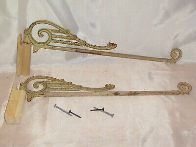 Pair of  Antique Ornate Cast Iron Metal Swing Arm Curtain Rod with Wood Brackets