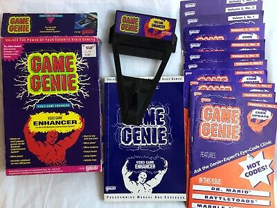 GAME GENIE for NIntendo NES Video Game Enhancer with a whole lot of Code Books!