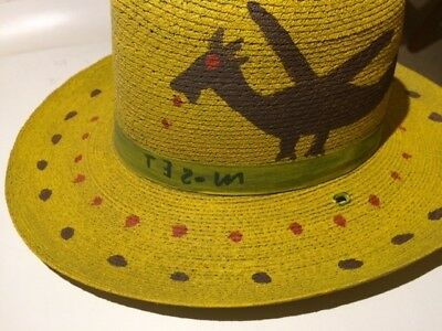 Mose T art, painted on an old hat, signed