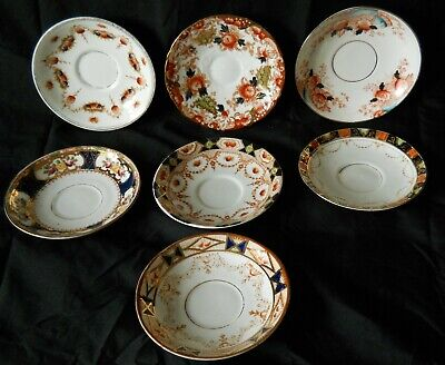 A collection 7 decorative Antique / Vintage Hand Painted Bone China Saucers