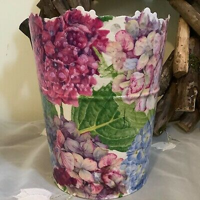 Hand decorated metallic flower pot with lace and colourful hydrangeas