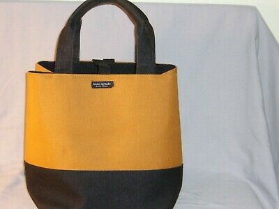 Kate Spade tote bag. Two toned harvest gold and black color.
