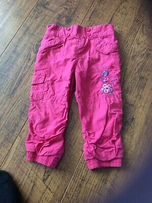 Girls pink trousers with flowers on left leg age 12-18 months