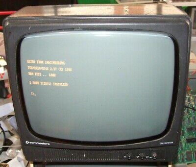 Commodore 1201 12in amber CRT monochrome monitor with composite input