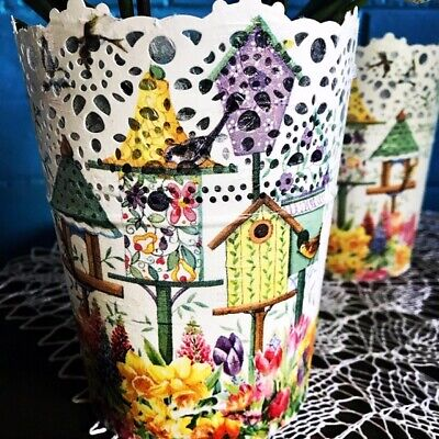Modern galvanised steel hand decorated planter pot with colourful birdhouses