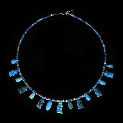 * An Egyptian Faience Bead and Amulet Necklace, 18th Dynasty, ca. 1550 - 1295 BC