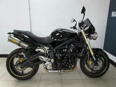 2010 TRIUMPH STREET TRIPLE 675. Arrow cans and a Fly screen
