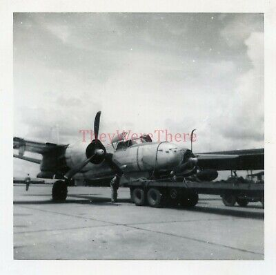 *WWII photo- Douglas A 26 Invader Bomber plane gets tied to Army Truck Flatbed*