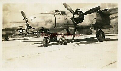 *WWII photo- US AAF GI posed w/ parked Douglas A 26 Invader Bomber plane*