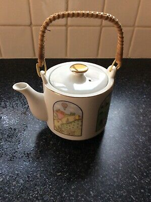 Japanese Teapot With Pictures Around The Side