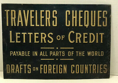 1915 Tin Over Cardboard Travelers Cheques Embossed Sign