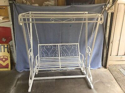1950's wrought iron love seat swing set. Ex condition.
