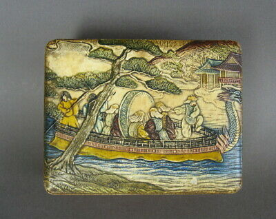 Japanese box with embossed leather top , scenes of river boat and warriors.