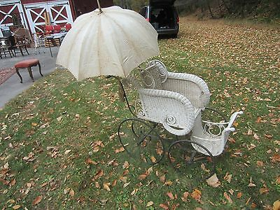 Beautiful antique wicker baby carriage with parasol good condition.
