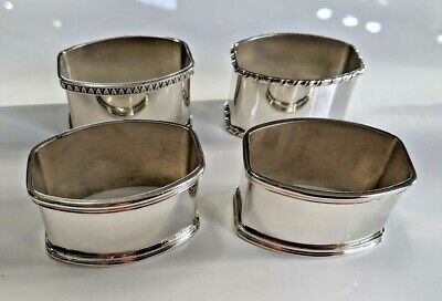 : Four heavy silver matched napkin rings set continental 800 silver