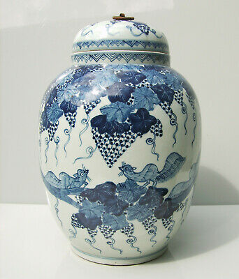 Chinese blue and white porcelain squirrel and grape jar and cover
