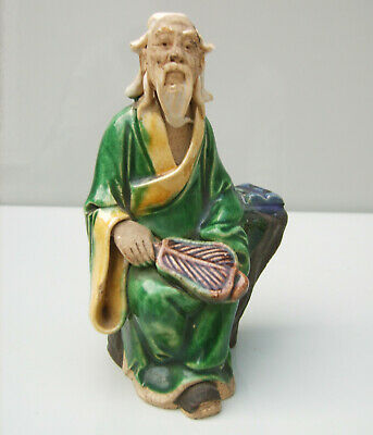 Chinese Sancai type glazed pottery figure of a seated sage