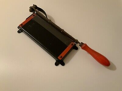 Vintage paper trimmer guillotine. Photography/stamps?