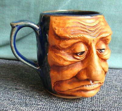 Stoneware unhappy face character drinking mug 4 inches tall