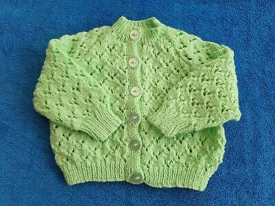 Hand made knitted baby cardigan in soft pale green wool. Suit age 0-6 months