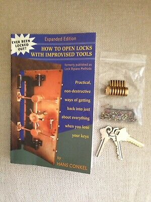 Cutaway Lock, Keys, Pins And A Book