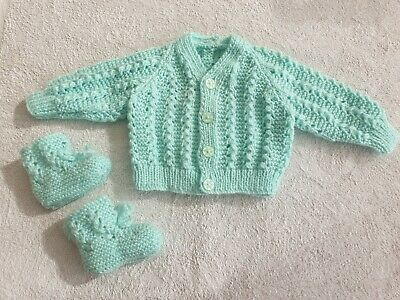Hand knitted new baby cardigan set with matching boots.Pale green soft wool. 0-3