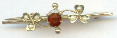 Victorian 9ct gold bar brooch with garnet and seed pearls