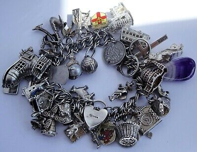 Wonderful vintage solid silver charm bracelet & 39 charms.Rare,open,move. 114.7g