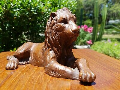 Molded & Carved Composite Seated Resting African Lion 20th Century Sculpture