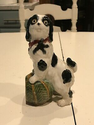 "A Vintage Possibly Reproduction 7"" English Staffordshire Mantle Dog With Ball"