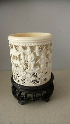 Chinese antique carved bovine brush pot. 8cm high 14cm with stand. 8cm wide