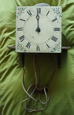 Antique single hand clock movement with painted dial and brass movement.