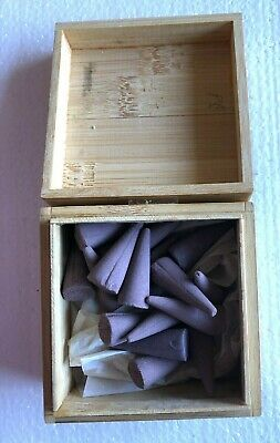Japanese incense cones in wooden box. Lavender