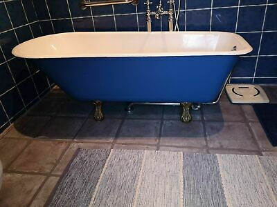 Antique freestanding cast iron roll top bath with chrome taps and shower