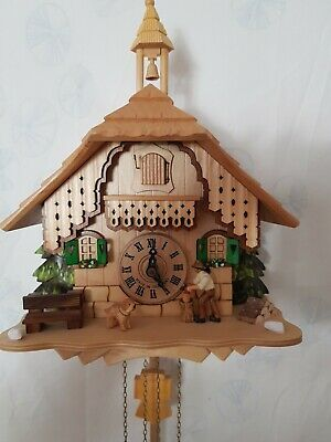 Animated Chalet Cuckoo Clock with moving Wood chopper in original box
