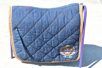 Eurostar Navy with rust dressage saddle pad