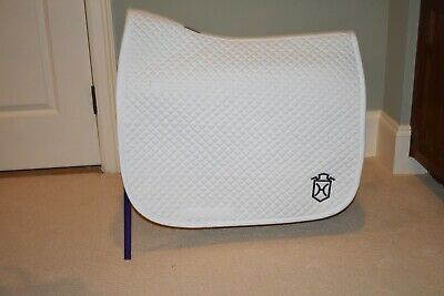 2 White dover dressage saddle pads with  Holsteiner logo