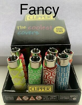 2 Clipper Lighters. rubber Case. full Size. refillable. Fancy Designs. Hand Sewn