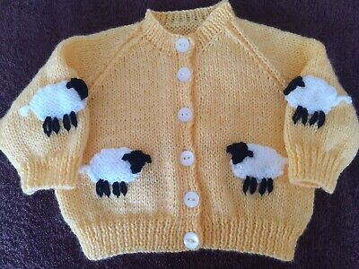 3 new baby\u2019s hand knitted mixed coloured woollen cardigans 18 inch chest