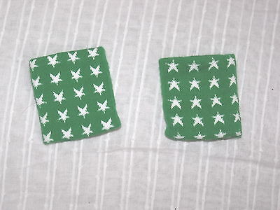 pair of green sweatbands with white star one size (R30.63)