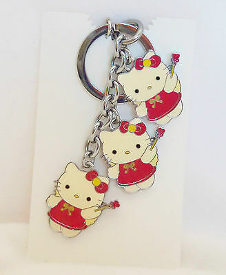 Three Hello Kitty with Red Dress and Heart Wand Enameled  Key Chain